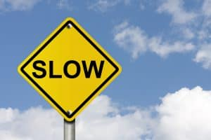 An American road warning sign with sky background and copy space for your message, Go Slow,